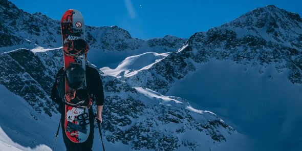 guy with snowboard dressed with base layer