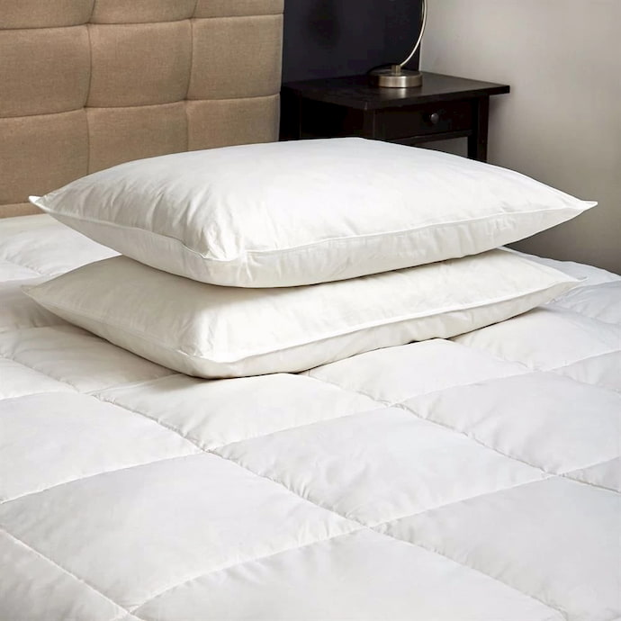 pillows above mattress cover