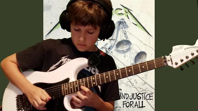 kid plays guitar