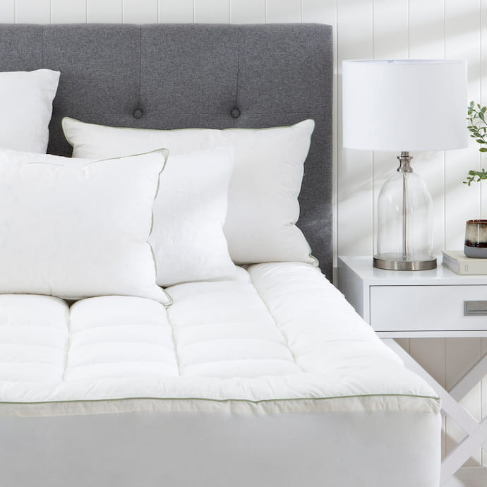 bedroom with mattress topper and pillows