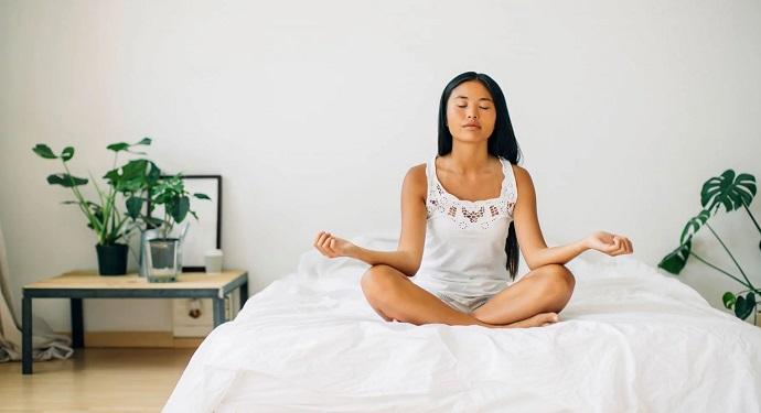 girl-meditating-at-home