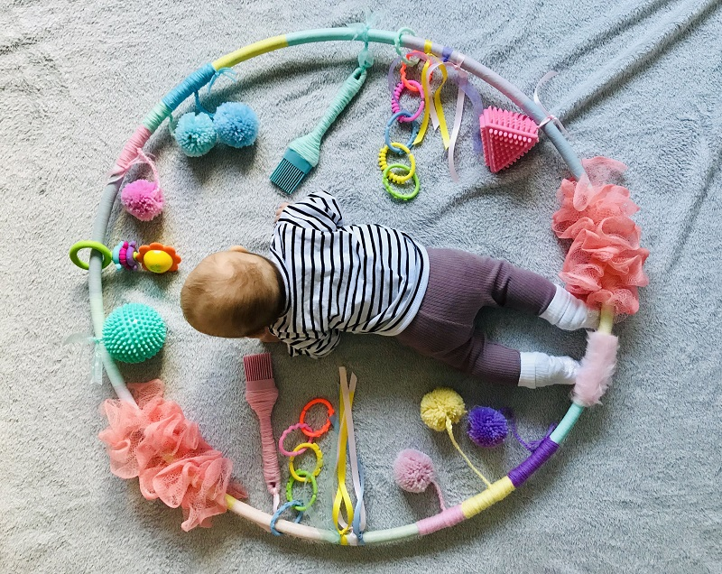 kid playing with sensory toys
