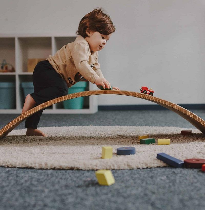 kid climbing balance board
