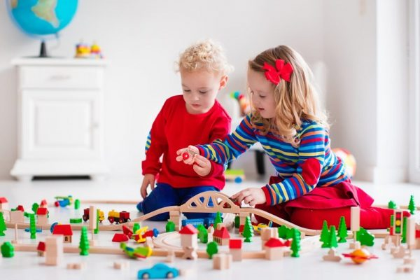 two kids playing with toys
