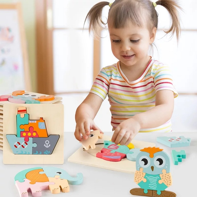 picture of a baby girl playing with a puzzle toy on a coffee desk
