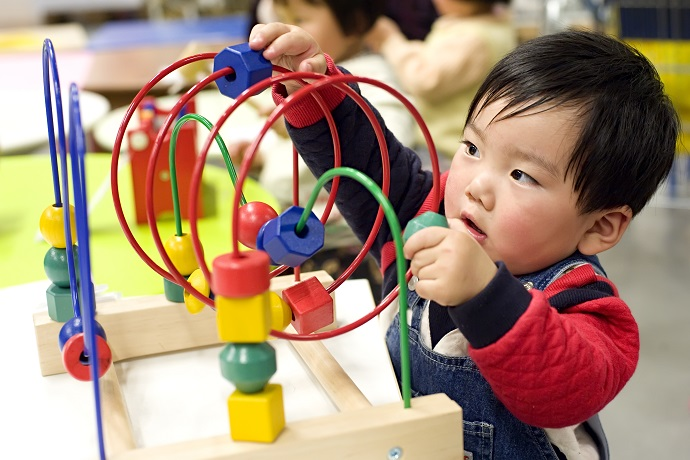 picture of a child playing with an educational toy