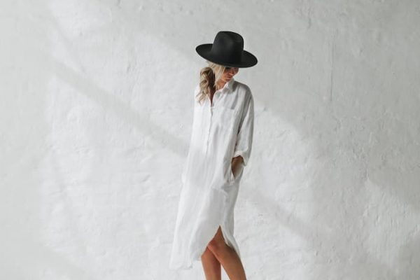 girl with white linen dress and black hat