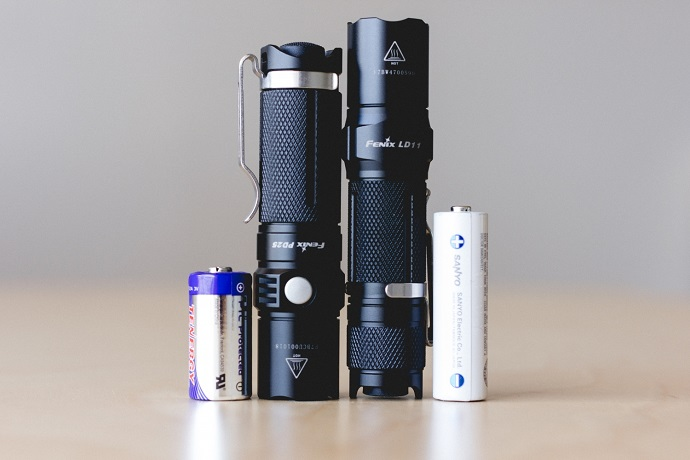 picture of two led torch beside two different batteries