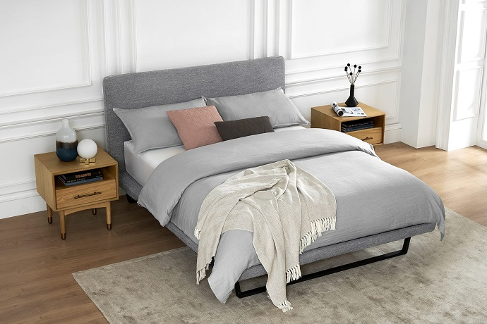 grey bed in simply designed room