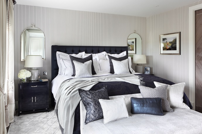 stylish luxury bed with so much pillows