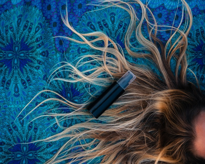 picture of a hair on a blue background