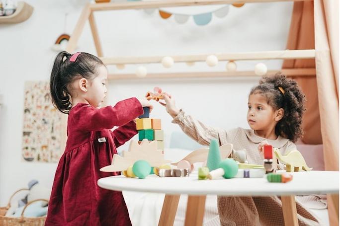 toddlers-girls-wooden-blocks-image