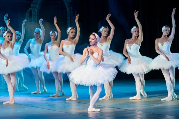 picture of ballerinas dancing on a stage in tutus