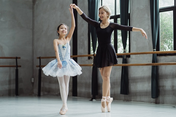 picture of a woman and a little girl in tutus in a studio dancing ballet