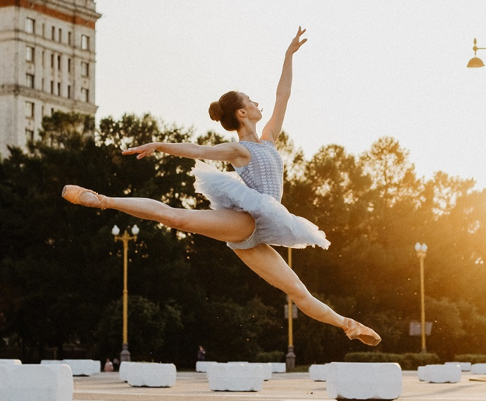 picture of a woman wearing a ballerina tutu dancing outside