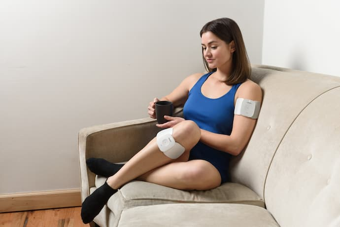 woman wearing a Transcutaneous Electrical Nerve Stimulation